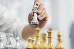 victory leader and success concept, business man playing take a checkmate figure another king with team on the chess board and royalty free stock images
