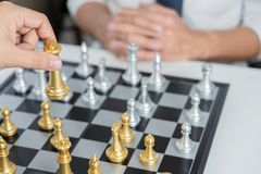 victory leader and success concept, business man playing take a checkmate figure another king with team on the chess board and stock photos