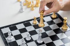 victory leader and success concept, business man playing take a checkmate figure another king with team on the chess board and royalty free stock photo