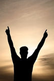 Victory is Mine. Victory sign in the sunset stock photos