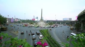 The Victory monument in Thanon Phaya Thai square in Bangkok,. The chaotic traffic in Thanon Phaya Thai square in Bangkok, Thailand stock video footage