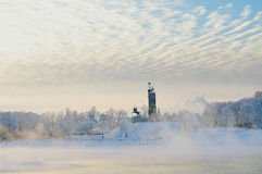 Victory monument and Trinity church in winter fog in Veliky Novgorod, Russia Royalty Free Stock Images