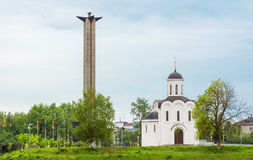 Victory Obelisk and the Temple of Michael Tverskoy on the bank o stock photo