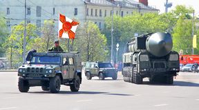 Victory parade 2012. MOSCOW, RUSSIA - MAY 6: Light multirole vehicle Rys and intercontinental ballistic missile Topol-M exhibited at the annual Victory day Stock Photo