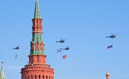 Victory parade rehearsal: Mi-8 with flags. MOSCOW - MAY 6: Mi-8 helicopters with flags of Russian armed forces fly over Kremlin during rehearsal of parade in Royalty Free Stock Image