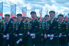 The Victory parade, soldiers shouting. SAINT-PETERSBURG, RUSSIA - MAY 09, 2015: The Victory parade, soldiers shouting Hurrah! marched on Palace bridge in St Royalty Free Stock Photography
