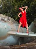 Victory pose on vintage airplane Stock Photos