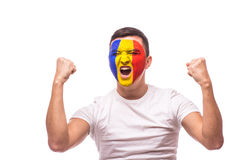 Victory, score and  goal scream emotions of Romanian football fan in game support of Romania national team. On white background. European football fans concept Royalty Free Stock Image