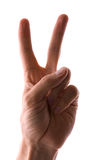 Victory sign. Hand showing a victory sign on a white background royalty free stock image