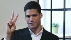 Victory Sign by Black Businessman. Young creative designer , good looking stock footage