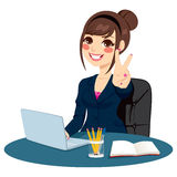 Victory Sign Businesswoman. Successful businesswoman making victory hand sign in front of his desk while working typing on laptop Stock Images