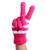Victory Sign. Hand in knitted pink gloves isolated on white Royalty Free Stock Images
