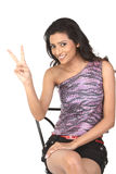 Victory sign made by indian girl Stock Photography