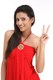 Victory sign made by slim girl Royalty Free Stock Photo