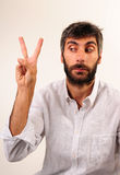 Victory Sign Man. Man Doing Peace and Victory Sign Stock Photo