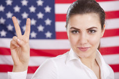 Victory sign over american flag Royalty Free Stock Images