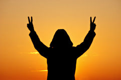 Victory sign in silhouette Stock Photo