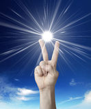 Victory sign in sky Royalty Free Stock Image