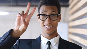 Victory Sign by Successful Black Businessman in Suit, Portrait Stock Photo