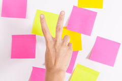 Victory Sign - Wall covered with sticky notes Royalty Free Stock Photos