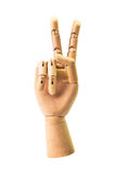 Victory sign from wooden hand Royalty Free Stock Photography
