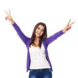 Victory!. Smiling woman showing victory sign royalty free stock photography