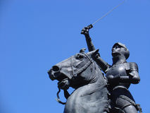Victory Statue. An old park statue from the late 1800's holds up a sword up in an apparent show of victory. The statue depicts a female stock photography