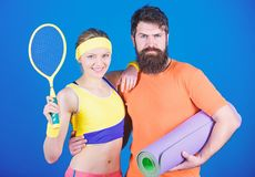 Victory and Success. Sporty couple training with fitness mat and tennis racket. Happy woman and bearded man workout in royalty free stock photo