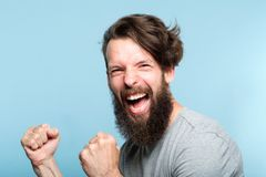 Victory success thrill winner excited agitated man. Victory success and achievement. excited thrilled agitated guy making a winner gesture. hipster man portrait royalty free stock photo