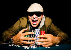 Victory time. Man winning on the poker game.Selective focus on the man head Stock Images
