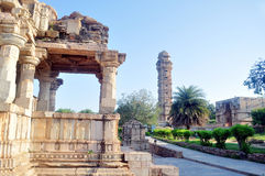 Victory tower. Tower inside chittorgarh fort in Rajasthan India with ruins of temple in the foreground Royalty Free Stock Photo