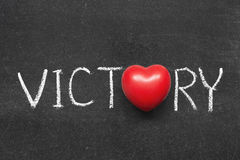 Victory. Word handwritten on blackboard with heart symbol instead of O royalty free stock images