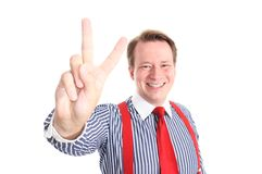 Victory. Young businessman smiling while showing you the victory sign - isolated on white background and retouched Royalty Free Stock Photo