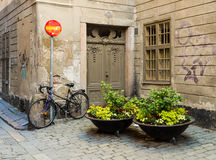 Old Town in Stockholm with its narrow ally and charming houses is this old and toil worn torn house wit a bicycle outside. Royalty Free Stock Photos