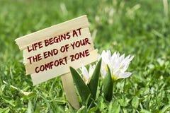 A vida começa no fim de sua zona de conforto imagens de stock royalty free