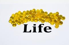 Vida con el aceite de pescado Imágenes de archivo libres de regalías