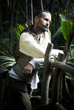 Hombre en bosque salvaje Fotografía de archivo libre de regalías