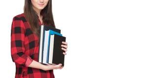 Vida feliz do estudante Estudante fêmea novo alegre atrativo que guarda os livros, isolados no branco Imagem de Stock