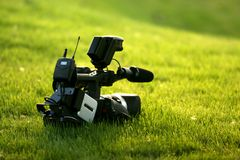 Video. A video camera on the grass Stock Image