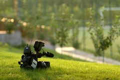 Video. A video camera on the grass Royalty Free Stock Photos