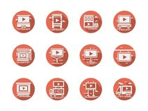 Video advertising screens red round icons. Abstract white silhouette symbols for video advertising screens. Monitors, displays and other spaces on building Royalty Free Stock Photo