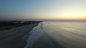 Video Aerial Beach and Ocean Waves early morning North Carolina stock footage