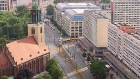 An aerial shot of trams crossing an intersection. Video of An aerial shot of trams crossing an intersection stock video