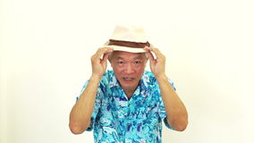 Video Asian senior man wearing blue hawaii shirt and hat. Ready to go vacation stock footage