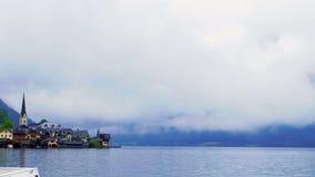 Video of Austria, Hallstatt. Beautiful historic village near lake on the mist day with copy space stock footage