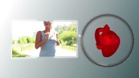 Video av en kvinna som joggar med en hjärtaanimering arkivfilmer