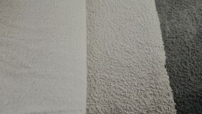 Background of the detail of a terrycloth towels in different shades of gray and white
