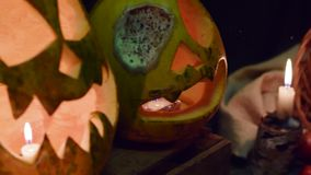 Video background for halloween. Three pumpkins with candles stock video footage
