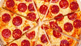 A video  of the background pepperoni pizza. Footage. A video of the moving background slices pepperoni pizza. Footage stock footage