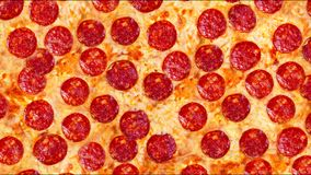 A video of the background pepperoni pizza. Footage. stock footage